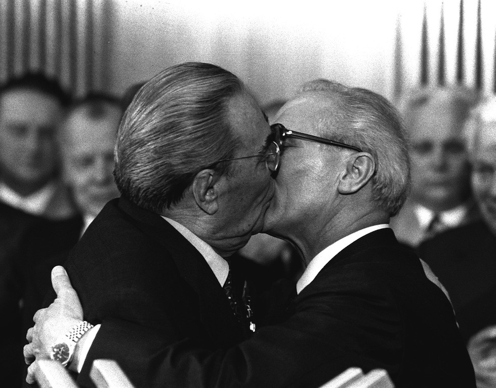 "Berlino, East Germany, Oct. 4, 1979 - Soviet President Leonid Brezhnev and East German leader Erich Honecker change kisses after Brezhnev was honored with the title ""Hero of the German Democratic Republik"" and the ""Karl Marx Medal"". Brezhnev participates in the celebrations marking the 30th anniversary of the East German State`s foundation. (AP Photo/Helmuth Lohmann/stf)"